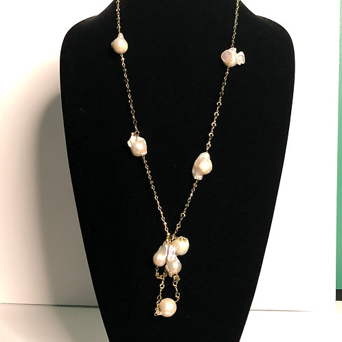 Long gold necklace with large white Freshwater pearls