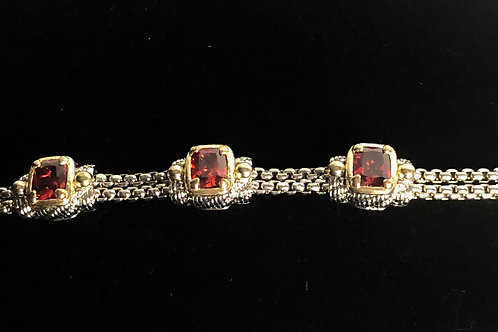 Two tone line bracelet with red stones and magnet clasp