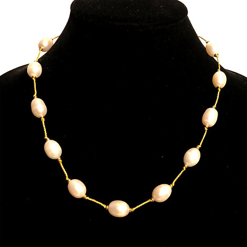 Gold threaded string with large white oval Freshwater pearls