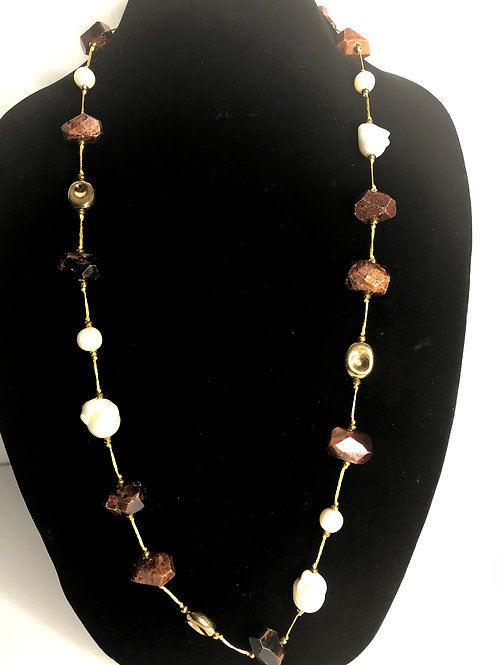 Long white FWP necklace with gold decorative pieces