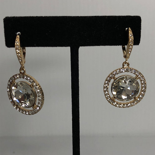 Gold round lever back earrings with large clear stone in  center