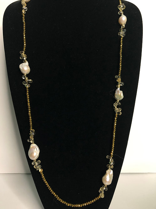 Long gold necklace with large white Freshwater Cultured pearls