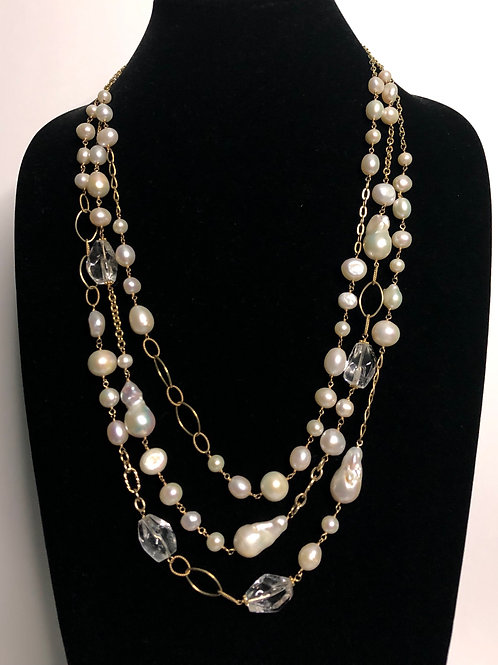 Triple strand gold necklace with variety of different pearl shapes