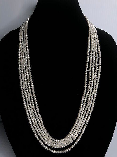 5 strands all notted of white  FWP with several sterling bars