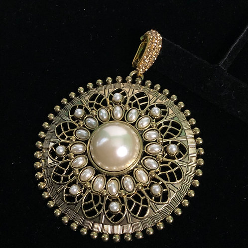 Large gold circle enhancer with white pearls
