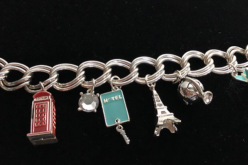 Travel charm bracelet with toggle clasp