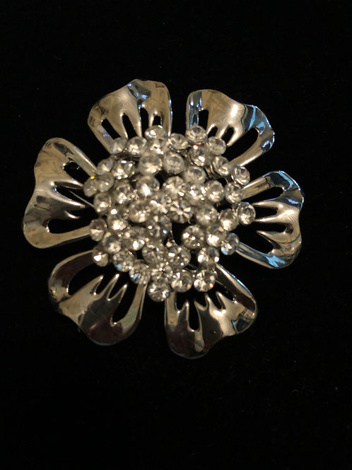 Silver flower with clear crystals in center