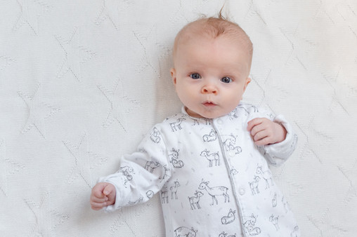 Baby cooing during baby photoshoot
