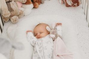 Newborn Baby in cot asleep