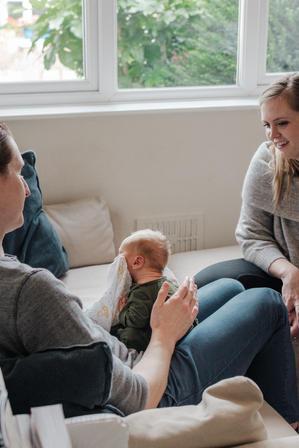Parent winding newborn baby during newborn photoshoot