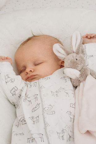 Newborn Baby in cot asleep, taken by Natalie Avery Photography North London Newborn Photographer