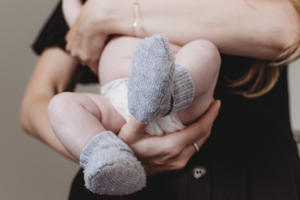 Mother holding newborn during photoshoot