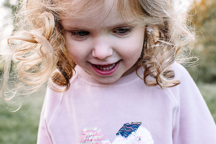 Sunlight in girls curls. Outdoor Family Photography North London.