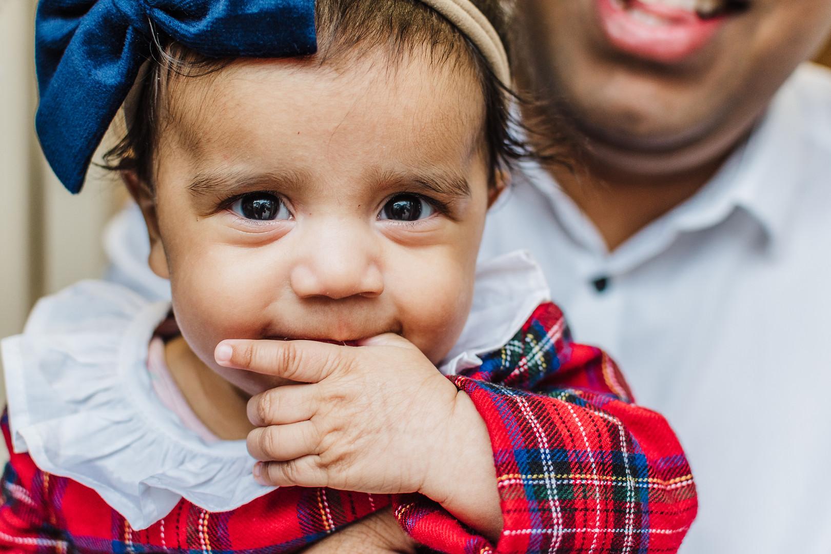 Baby chewing fingers taken by Natalie Av