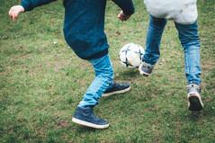 Family Photoshoot boys playing football