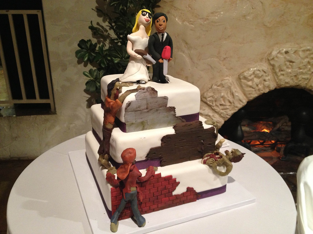 Our wedding cake fighting zombies at the apocalypse