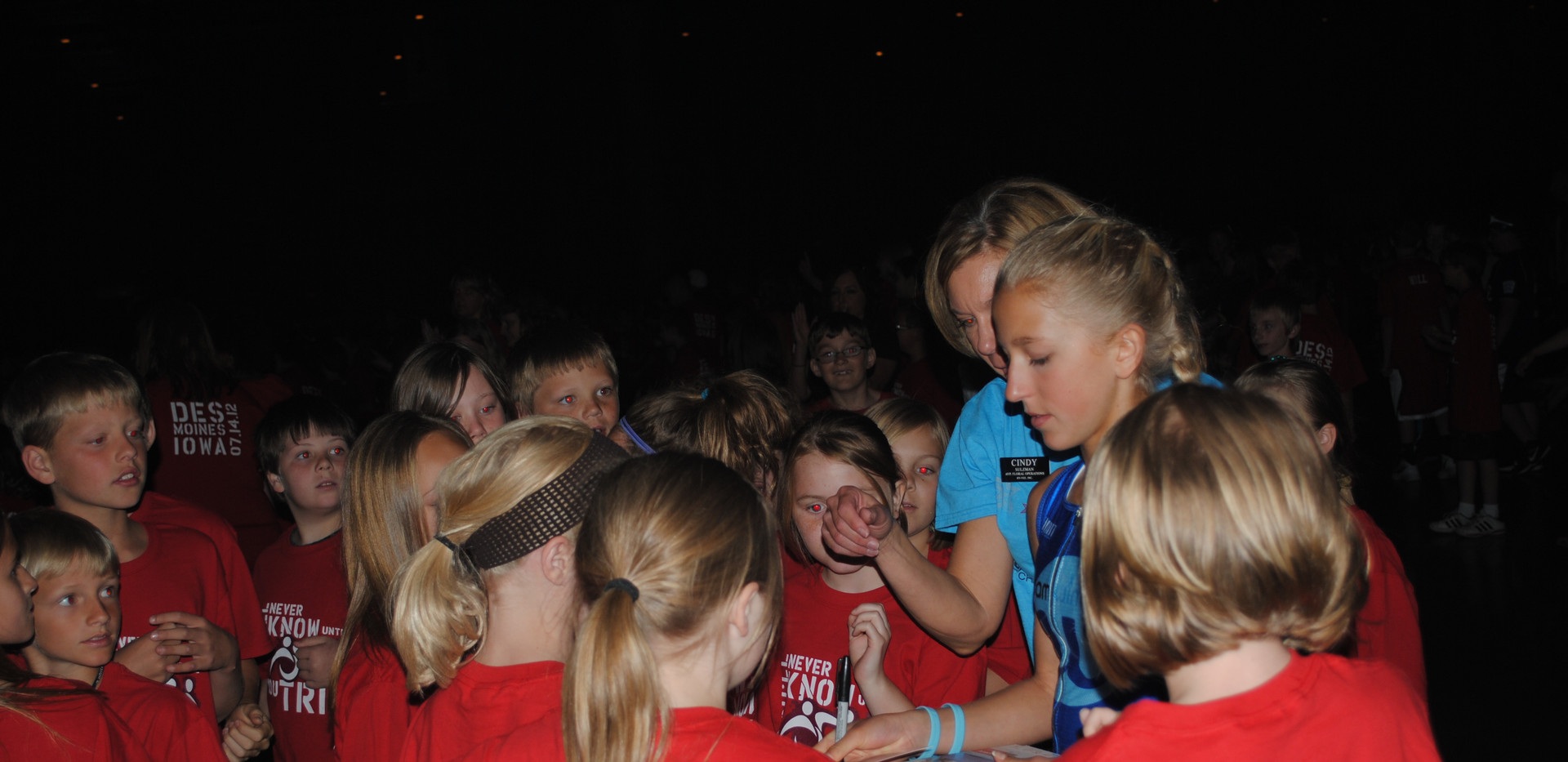 Giving autographs at Hy-Vee Exercise Your Character event 2012