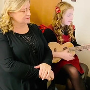 """Kyla Carter singing """"Can't Help Falling in Love"""" with her White Christmas Tour teacher Lori Betz"""