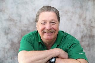Ray's headshot green shirt.jpg