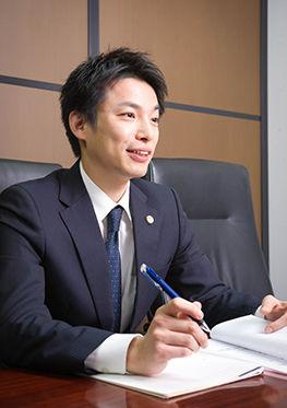 相談を受ける加藤健一郎弁護士