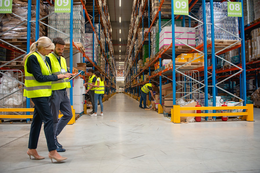 Working in warehouse, managers and workers.jpg