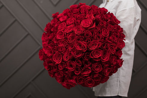 Happy girl received a huge bouquet of re