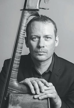 """Graham is Principal Double Bass of English National Opera, Senior Professor at the Royal Academy of Music in London, and Double Bassist with the Nash Ensemble.  He was a member of the Philharmonia Orchestra from 1998- 2011, and as a guest works regularly with the Berlin Philharmonic. As a guest principal home and abroad Graham has led many orchestras such as the Royal Concertgebouw, Stuttgart Radio, Chamber Orchestra of Europe and the London Symphony Orchestra.  Over the years Graham has performed and recorded with many soloists and chamber ensembles including Anthony Marwood, James Crabb, Pekka Kuusisto, and Imogen Cooper; the Florestan, Gould, and Kungsbacka Piano Trios, the Belcea and Takacs Quartets and the Aronivitz Ensemble.  In 2007 Graham was invited by Steven Isserlis to perform at the IMS Prussia Cove Chamber Festival followed by a national tour and concert at the Wigmore Hall. This resulted in IMS Prussia Cove winning the chamber prize at the prestigious Royal Philharmonic Society Awards. His recording of Schubert's Trout Quintet with Paul Lewis and the Leopold String Trio is praised as """"one of the finest modern Trouts available"""" (The Sunday Times).  Graham plays on a 1750 double bass attributed to Testore. He is extremely thankful to the Stradivari Trust for their support."""
