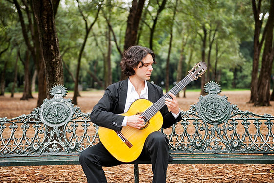 """A featured artist on the cover of Classical Guitar Magazine, Morgan Szymanski was selected as a finalist for the 'Outstanding Young Artist Award' by MIDEM Classique/IAMA.  Born in Mexico City in 1979, Morgan Szymanski started playing the guitar at the age of six. Early studies at the National Music School (Mexico) and the Edinburgh Music School led to a scholarship to study under Carlos Bonell and Gary Ryan at the Royal College of Music (RCM) in London, graduating in 2004 with first class honours. During his studies he won guitar prizes at the RCM as well as being awarded scholarships from the Tillett Trust, Countess of Munster Musical Trust, Leverhulme Trust, Wall Trust, FONCA and a scholarship to study at the Conservatorium van Amsterdam. He went on to become the first solo guitarist to be selected by the Young Classical Artist Trust and was awarded a Junior Fellowship at the RCM, where he completed his Master's degree with distinction.  A top prize-winner at international competitions, Morgan won first prize at the National Guitar Competition in Mexico. Performances as a soloist and with orchestras have taken him to concert halls and festivals in Argentina, Austria, Belgium, Bermuda, China, Chile, France, Germany, Guatemala, Holland, Ireland, Italy, Luxembourg, Mexico, Macedonia, Portugal, Spain, Switzerland, Scotland, USA, South Africa and Zimbabwe. He is included in the Mexican Foreign Office publication """"El Mundo en las Manos"""" for his contribution as an ambassador of music and Mexican culture overseas.   In recent years Morgan has given recitals at major UK venues and festivals including the Wigmore Hall, Cadogan Hall, Bridgewater Hall, Purcell Room, Queen Elizabeth Hall, King's Place, The Sage Gateshead, Royal Opera House, and London International Guitar Festival. He has appeared as a soloist with orchestras such as the Academy of St. Martin in the Fields, Royal Philharmonic Orchestra, Hallé, Royal Northern Sinfonia, Filarmónica de la Ciudad de México, Orches"""