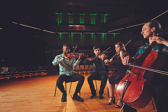 The Levaré Quartet was formed in 2017 at the Royal Northern College of Music, finding an almost instant rapport as a group. The quartet first performed publicly in the 2018 RNCM Chamber Music Festival and went on to win the college's Weil Prize.   They enjoy exploring a wide range of music styles with recent performances including music from Haydn to Schoenberg, and collaborations with the Manchester Roots Orchestra and the jazz pianist Gwilym Simcock in a performance of his compositions in the RNCM concert hall 2019. Members of the quartet also arrange, compose and improvise as a group as part of their rehearsal and performance routine, bringing more diversity and passion to the result.   The Levaré Quartet have played in many of Manchester's performance venues, including Manchester Cathedral, Gorton Monastery and the RNCM Concert Hall. Other notable performances include an evening recital for Manchester chamber music society (RNCM concert hall), the Solway arts society (Wigton),  Malvern music festival 2018, recital at the Buxton Opera house.   Furthermore, as students of the RNCM, while mainly studying with Donald Grant, they have received tuition from members of prestigious chamber groups including the Elias, Skampa, Cypress, Talich and Michelangelo quartets, Trio Gaspard and the Sitkovetsky Trio.