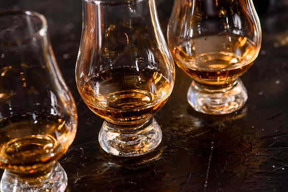 Three Glencairn Glass with whiskey on a