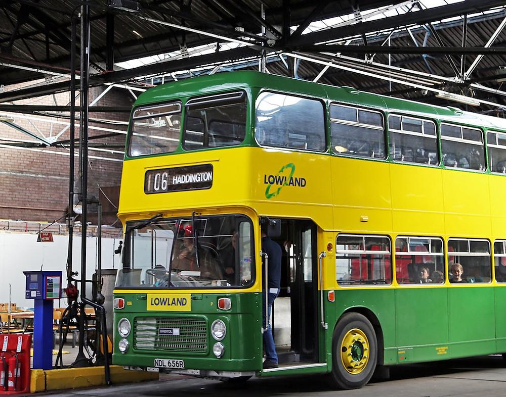 Picture of a vintage double decker bus parked alongside a FUELlink fuel management terminal