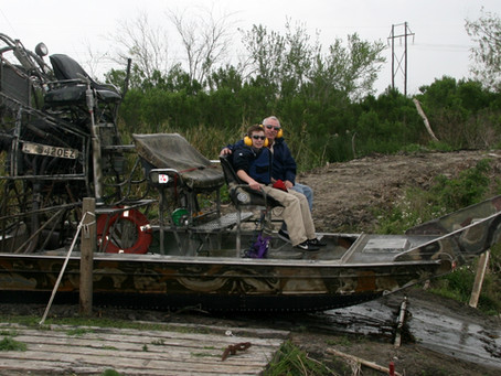 Feeding Alligators in the Louisiana Swamps.