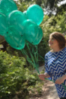 Rebecca Petruck, with balloons