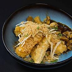 Fried tofu with mushroom sauce