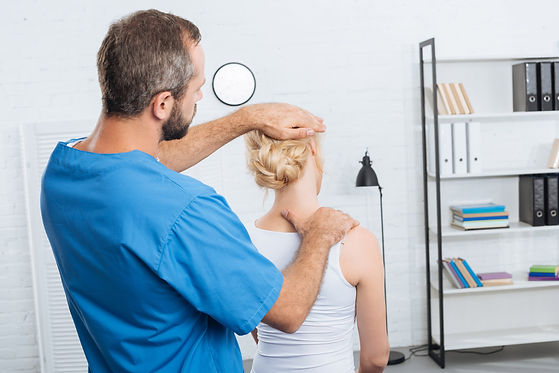 chiropractor-stretching-neck-of-woman-du