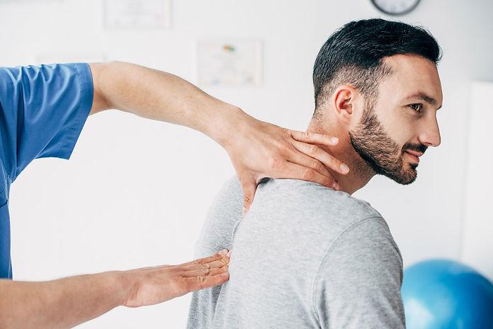 chiropractor-massaging-neck-of-good-look