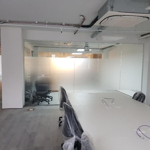Frameless glass partition walls London