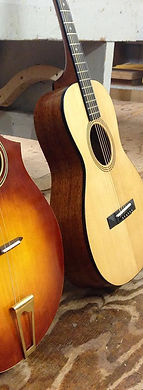 two recently finished guitars