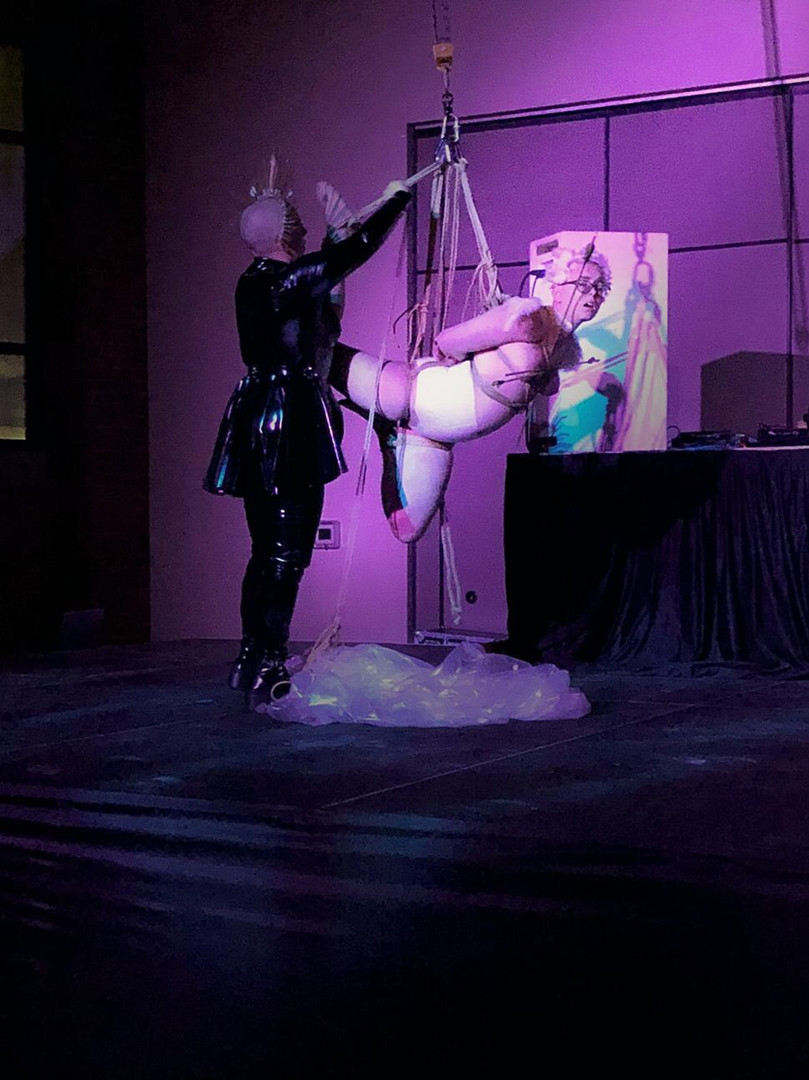 rope suspension performance at Northbound Leather's Fetish Party Anniversary
