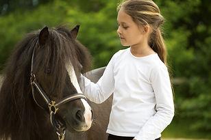 child and pony.jpg