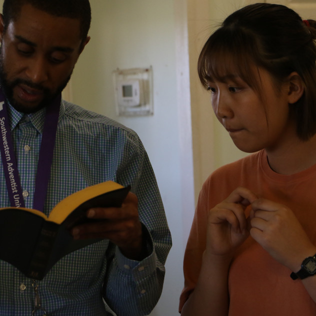 Mr. Anthony helps a student find an encouraging verse.