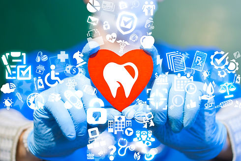 Dentist offers a red heart with tooth ic