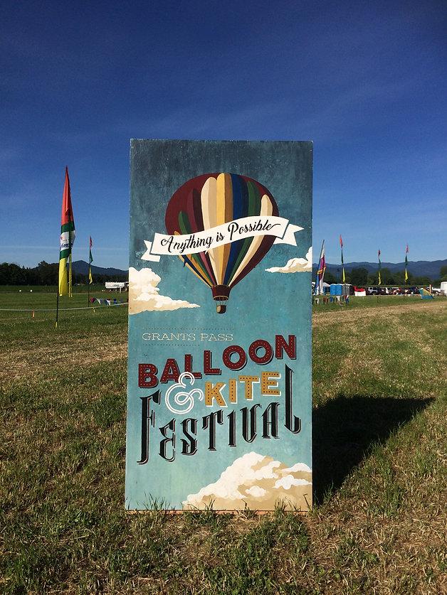 Grants pass graphic design custom hand painted sign balloon festival