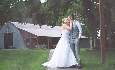bride groom love kissing rain trees grass shed