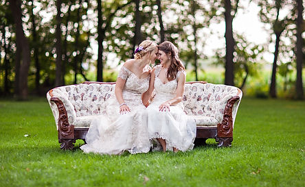 brides love smiles trees grass couch dresses