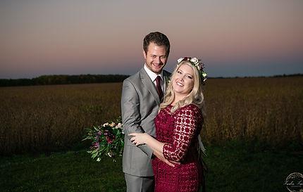 bride groom flowers field sunset evening