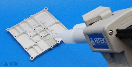 Manual dispensing gun dispensing adhesive onto plate