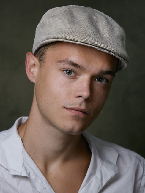 Ben Woodier headshot cap web.jpg