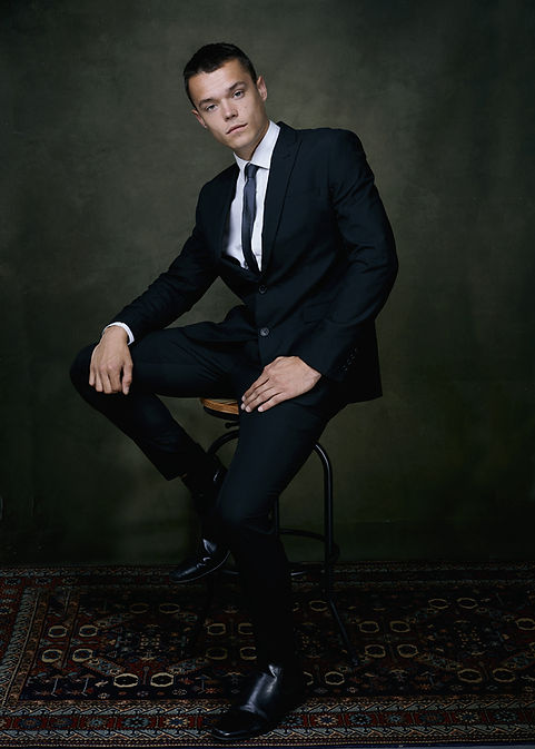 Ben suit on stool web.jpg