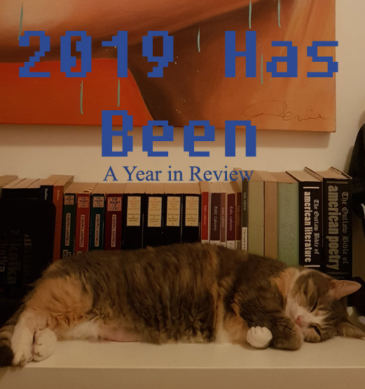 "Title of the post ""2019 Has Been: A Year in Review"" superimposed over a picture of a kitty sleeping in front of a shelf of books."